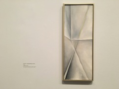 O'Keeffe often paints in extremely simple yet famine strokes. This is the petal and stem of a white flower.